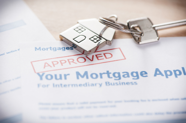 Approved mortgage application with house keys