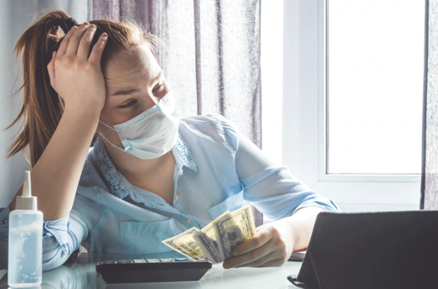 woman with mask frustrated about money
